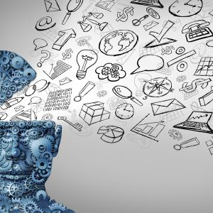 Business thinking and thinking businessman concept as an open human head made of gears with office icons spreading out as a symbol of financial intelligence and corporate education or seminar courses.